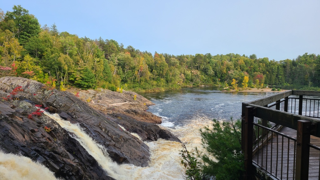 The main falls, and the day use beach in the distance.